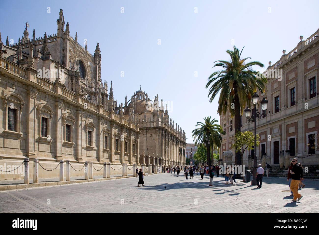Tourists in front of a cathedral, Seville Cathedral, Seville, Spain, Patrimonio de la Humanidad, Archivo de Indias - Stock Image