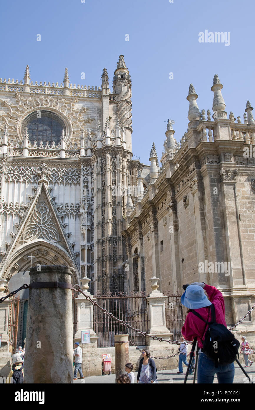Tourist taking a picture of a cathedral, Seville Cathedral, Seville, Spain, Patrimonio de la Humanidad - Stock Image