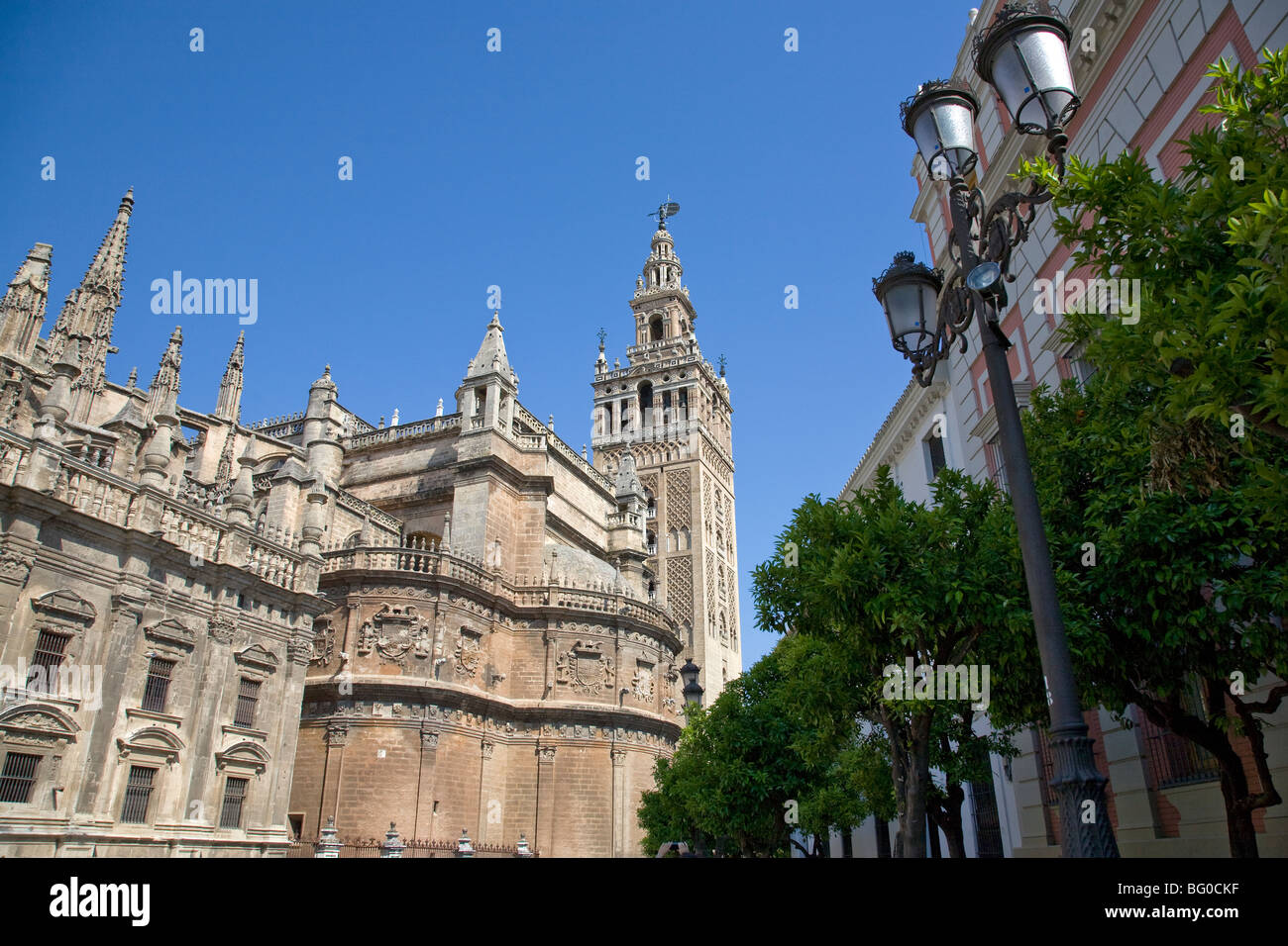 Lamppost in front of a cathedral, Seville Cathedral, Seville, Spain, Patrimonio de la Humanidad - Stock Image