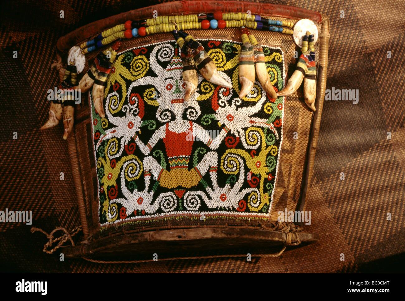 Baby carrier with full-figure motif, Kayan and Kenyah tribes, Sarawak, Borneo, Malaysia, Asia - Stock Image