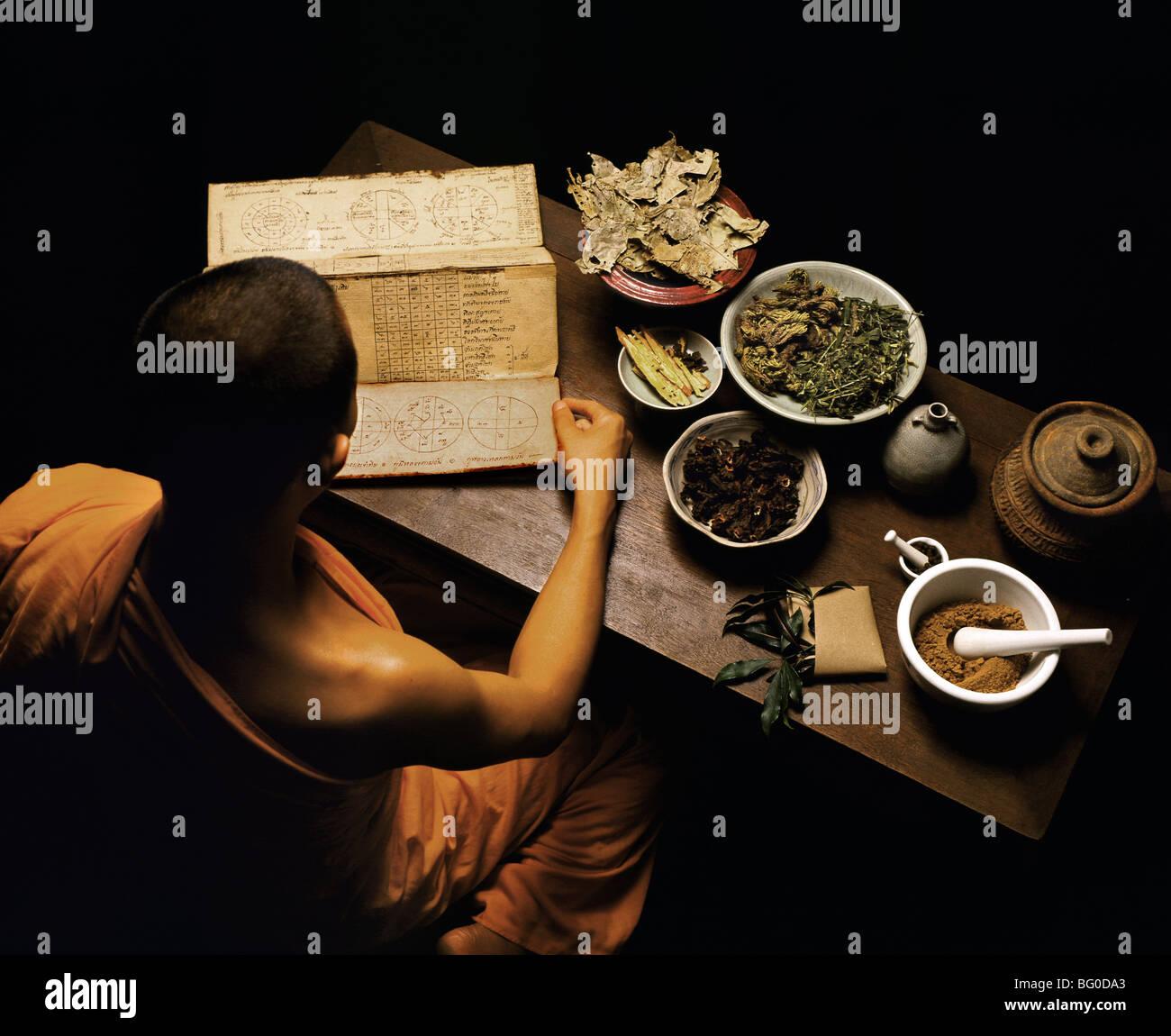 Thai monk preparing herbal medicines, Thailand, Southeast Asia, Asia - Stock Image