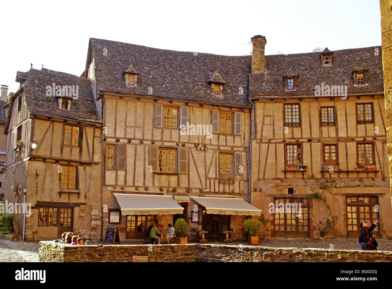 The old pilgrimage town of Conques in France. Mediaeval buildings in the main square. - Stock Image