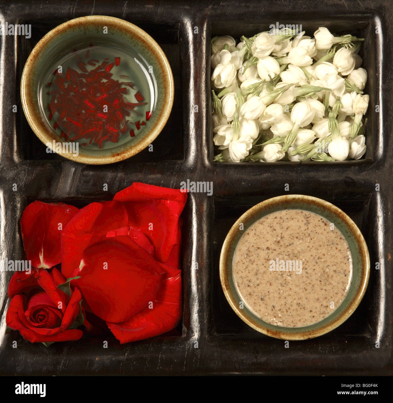 Ingredients for rose and jasmine scrub - Stock Image