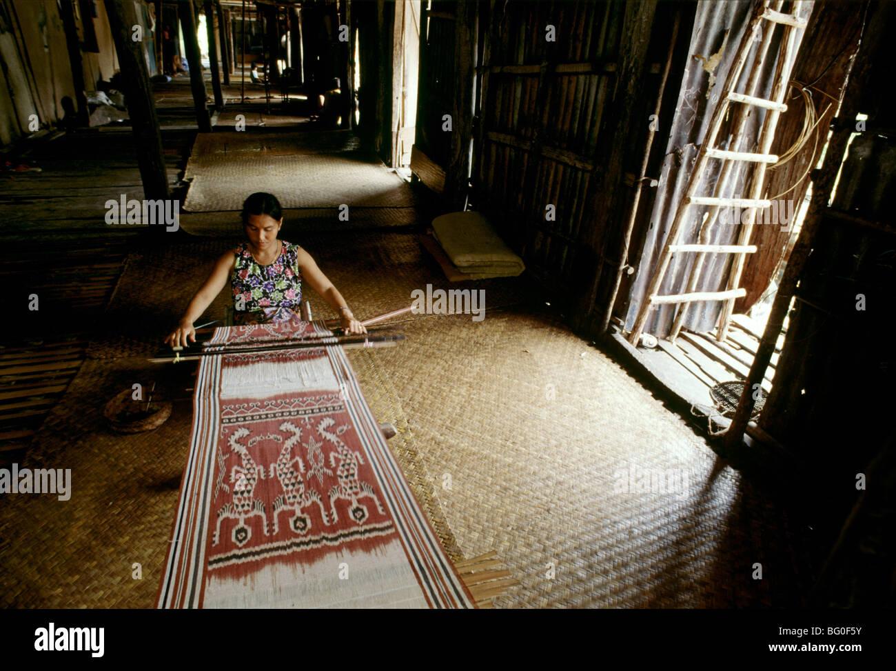 Ikat weaving at an Iban Longhouse, Sarawak, Malaysia, Southeast Asia, Asia - Stock Image