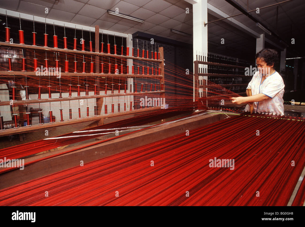 Stretching Silk at Jim Thomson Factory in Korat, Thailand, Southeast Asia, Asia - Stock Image