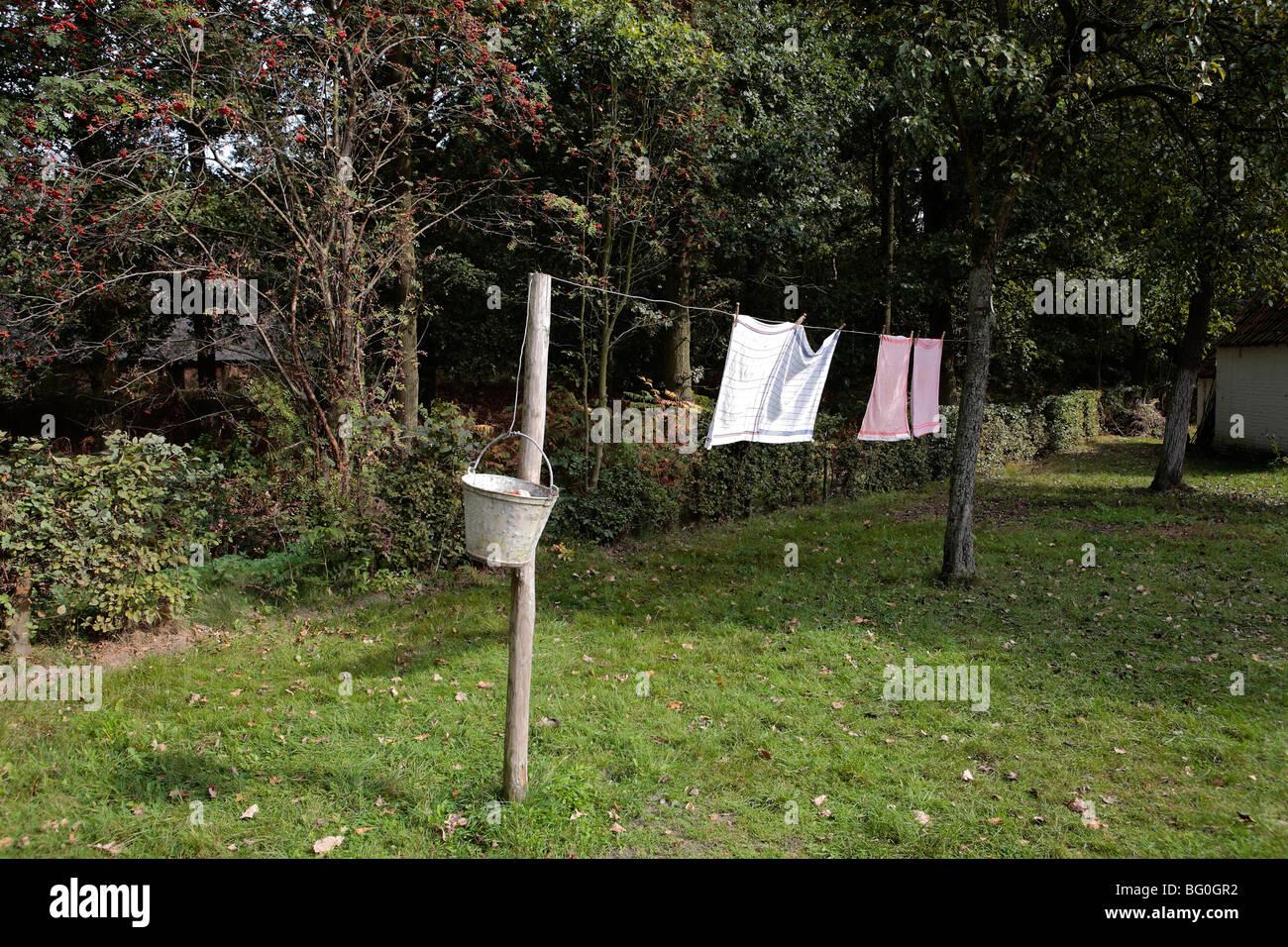 drying laundry on outside clothesline - Stock Image