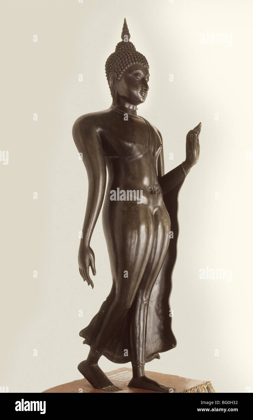 Famous Sukhothai Walking Buddha image, left hand in Abhaya Mudra, dating from the Sukhothai Period in the 15th century, - Stock Image