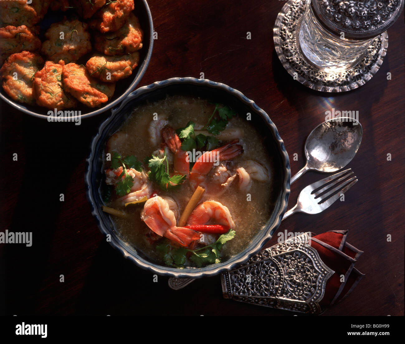 Tom Yum Goong Soup and Fish Cakes, Thailand, Southeast Asia, Asia - Stock Image