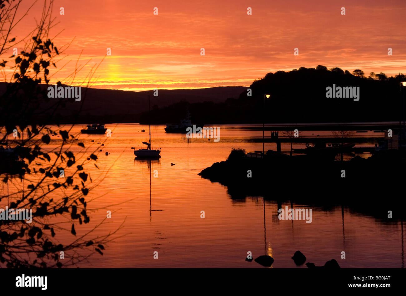 Sunrise over Tobermory Harbour and Calve Island in the Sound of Mull, Tobermory, Mull, Inner Hebrides, Scotland, - Stock Image