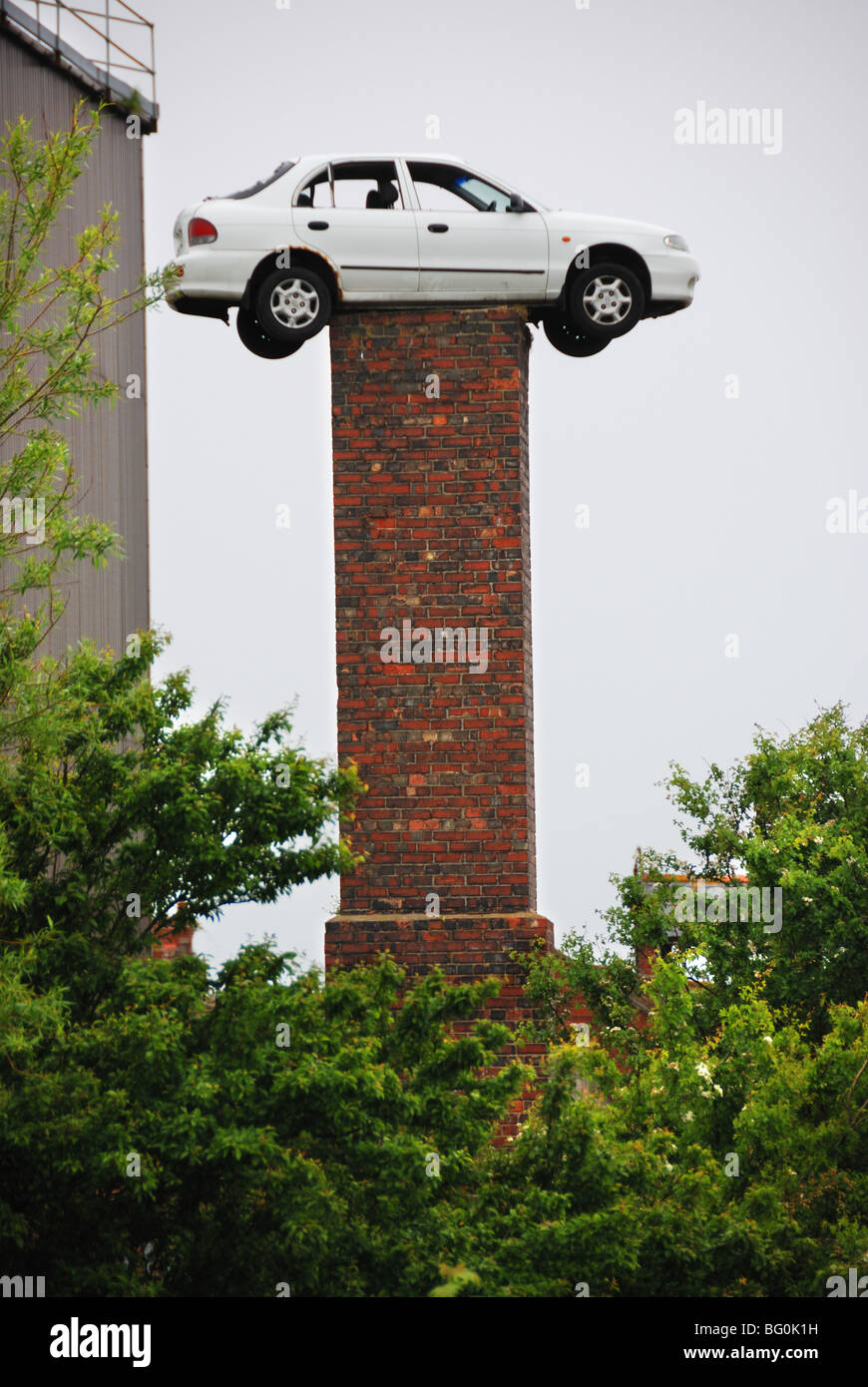 Car on top of chimney - Stock Image