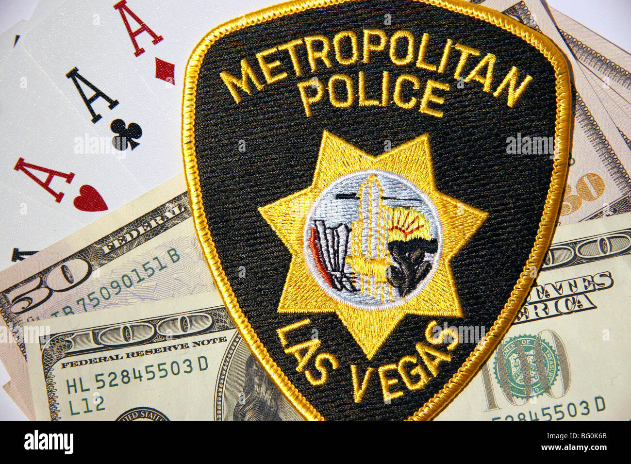 Ace cards, American dollars and patch of the Las Vegas Metropolitan Police Department - Stock Image