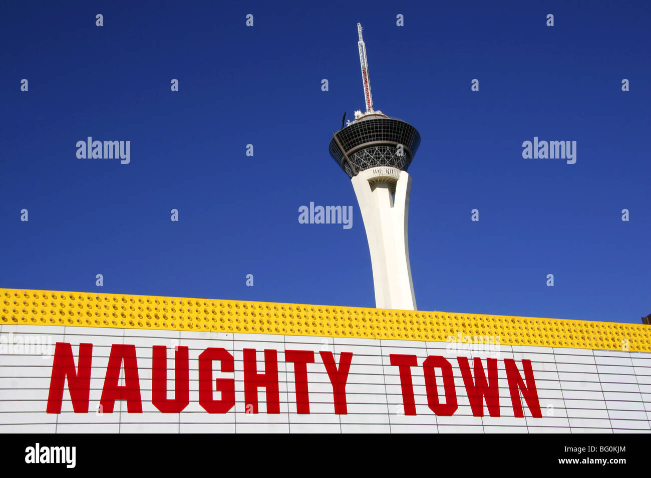 Naughty Town Sign below the Stratosphere Tower in Las Vegas Nevada. Stock Photo
