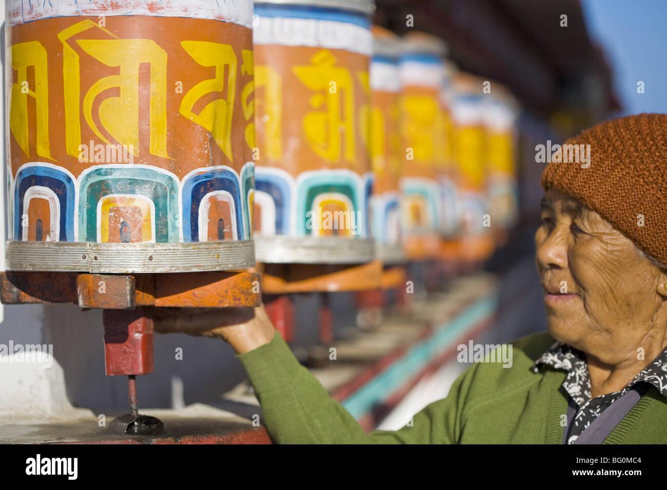 Tibetan pilgrim spins prayer wheels, Durpin Gompa (Zong Dog Pairi Fo-Brang Gompa), Durpin Hill, Kalimpong, West - Stock Image