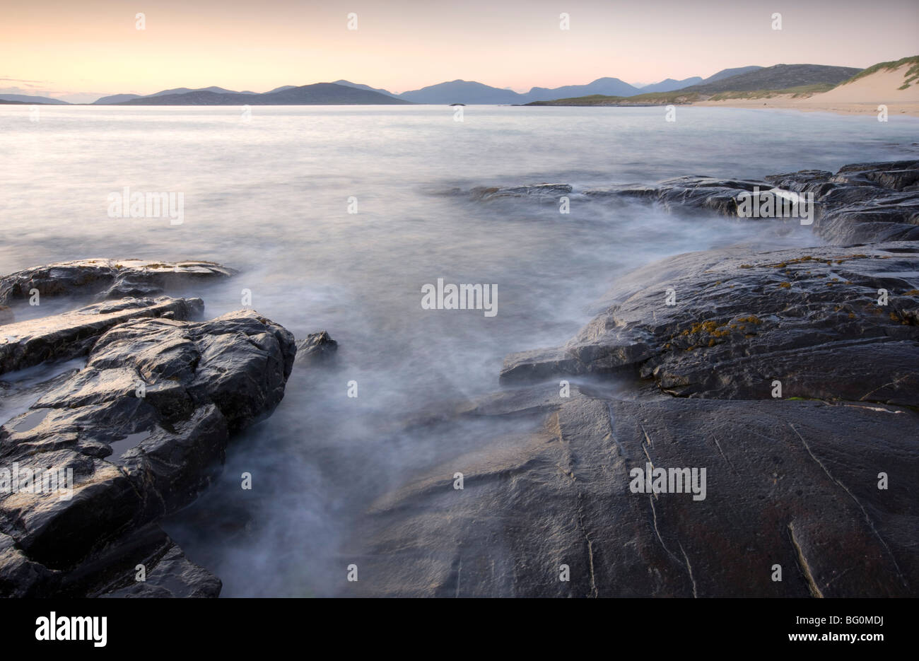 Taransay and North Harris from the rocky shore at Borve, Isle of Harris, Outer Hebrides, Scotland, UK - Stock Image