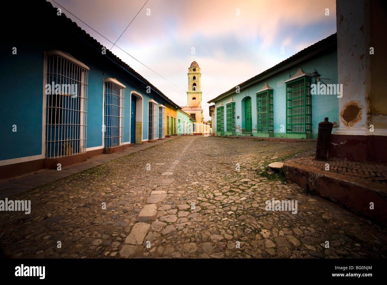 Deserted cobbled street looking towards the bell tower of Inglesia y Convento de San Francisco off Plaza Major, - Stock Image