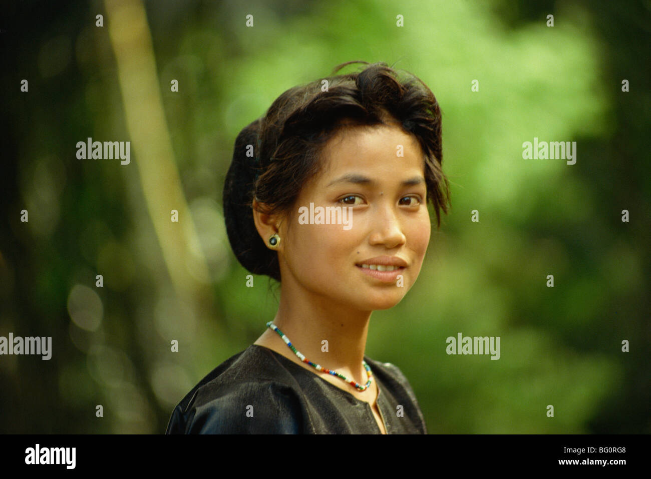 Tea girl, aged 13, at funeral, Sulawesi, Indonesia, Southeast Asia, Asia Stock Photo