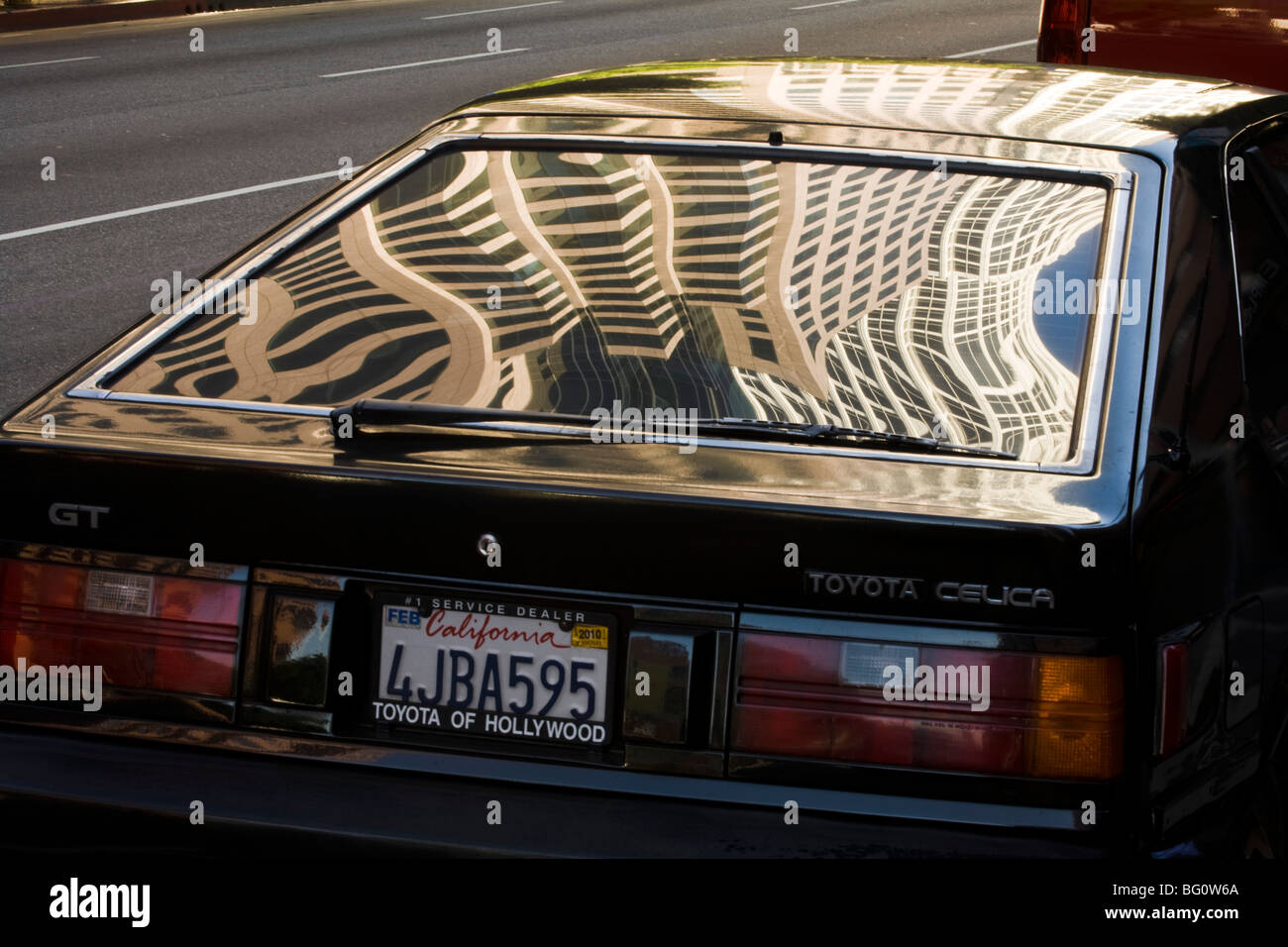 downtown buildings on Figueroa reflecting in a window of a car, Los Angeles, California, United States of America Stock Photo