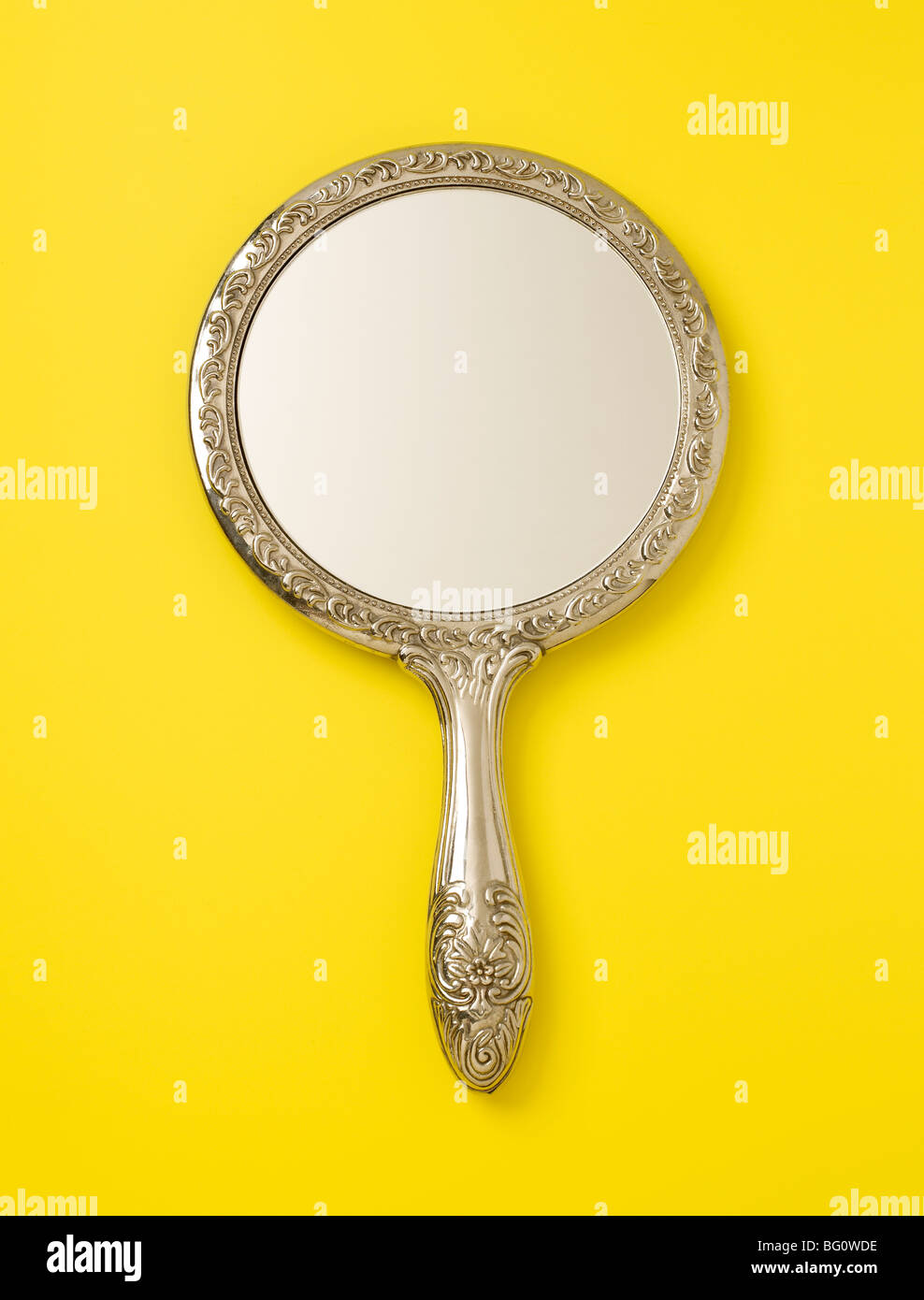 Silver Framed Hand Held Mirror - Stock Image
