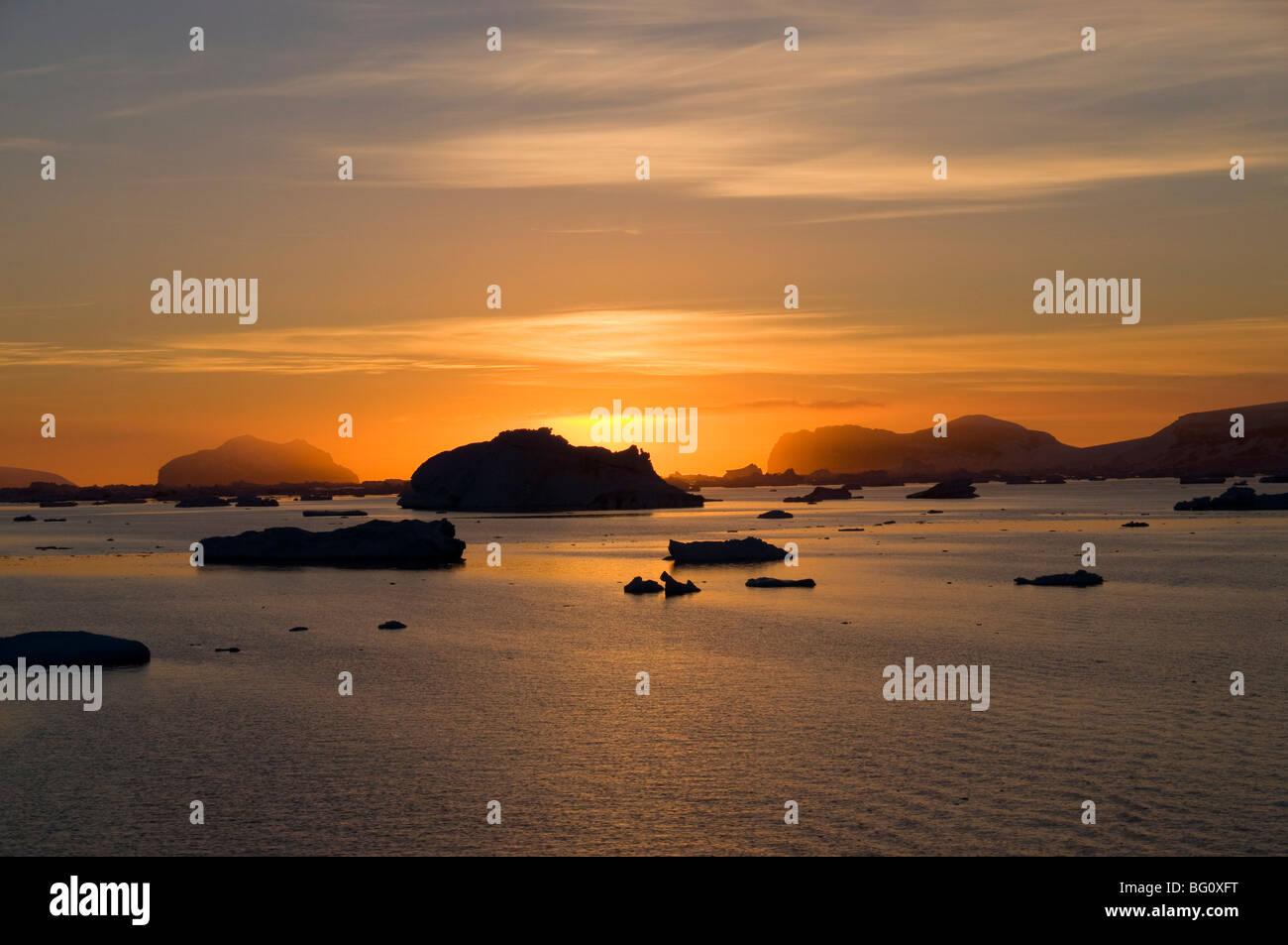 Sunrise on ice in the Antarctic Sound, The Antarctic Peninsula, Antarctica, Polar Regions - Stock Image