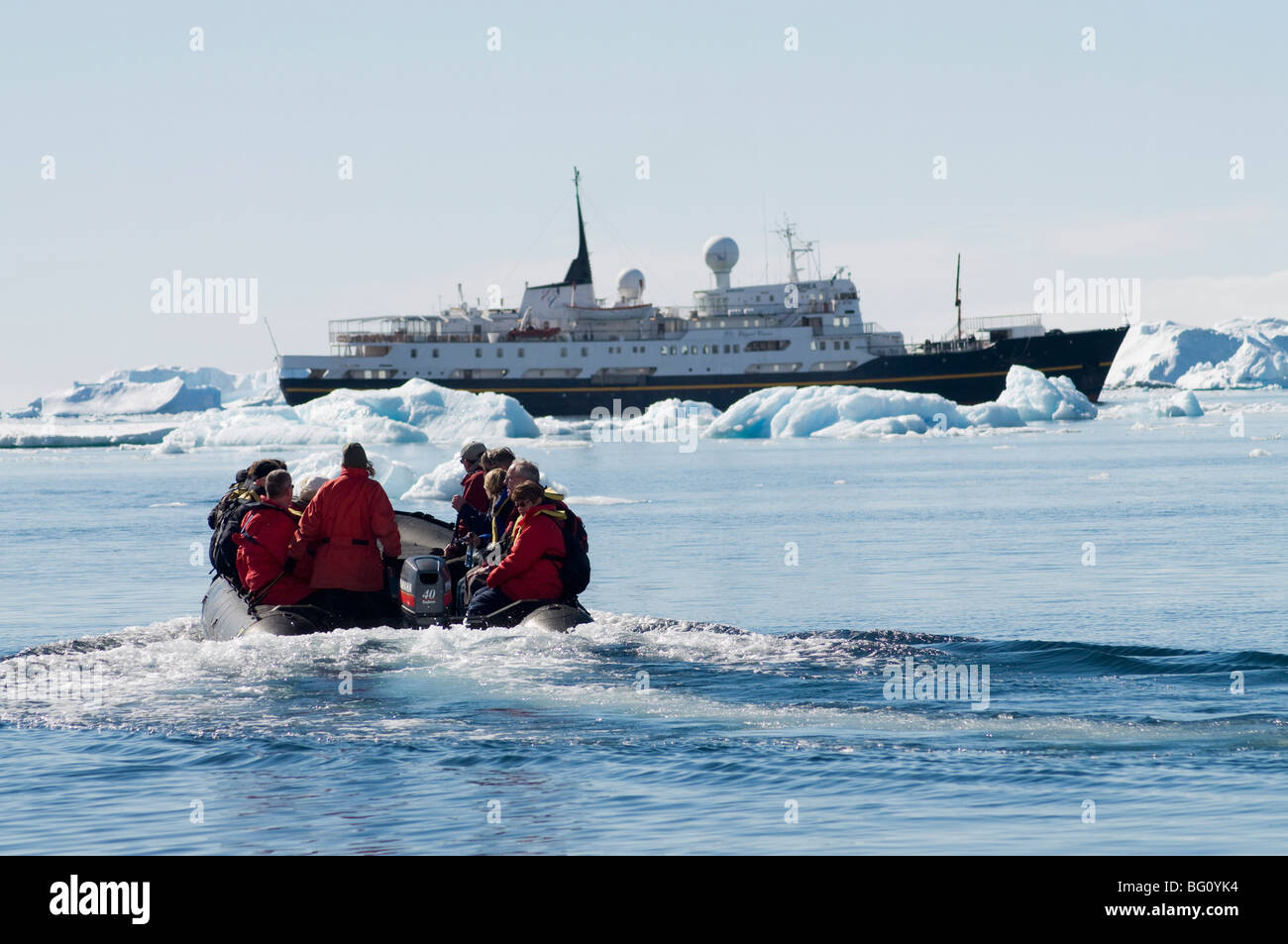 Zodiac ferrying visitors to and from boat at Brown Bluff, Antarctic Peninsula, Antarctica, Polar Regions - Stock Image