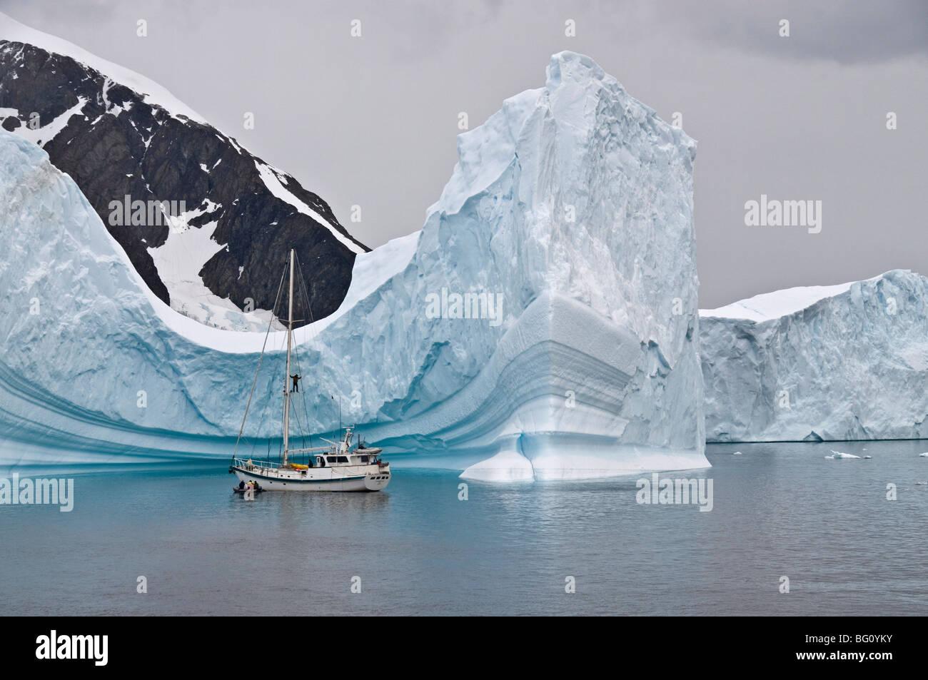 Sailing yacht and iceberg, Errera Channel, Antarctic Peninsula, Antarctica, Polar Regions Stock Photo