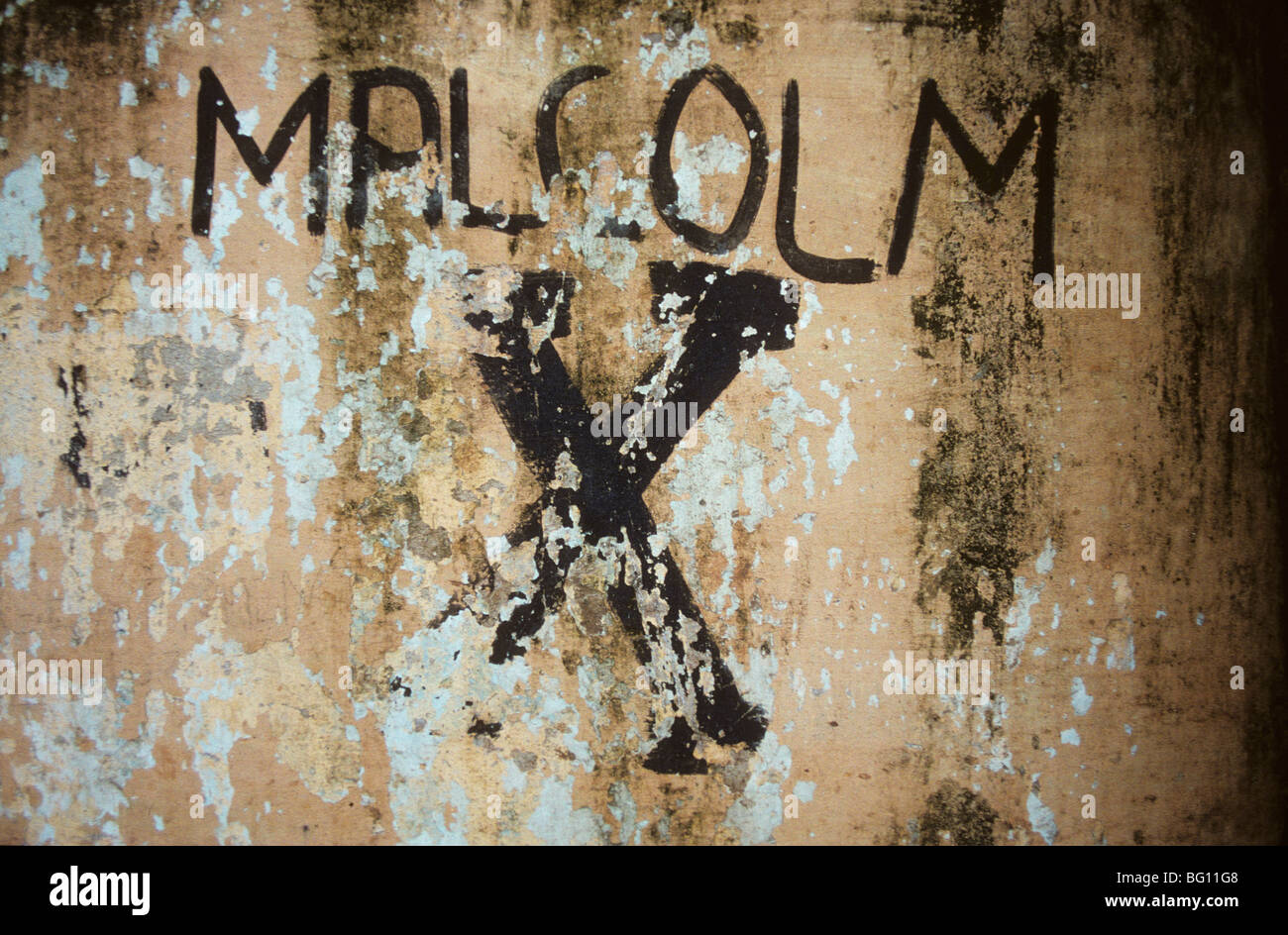 Malcom X written on a wall in Guatemala where, like in many parts of the less developed world and where certain - Stock Image