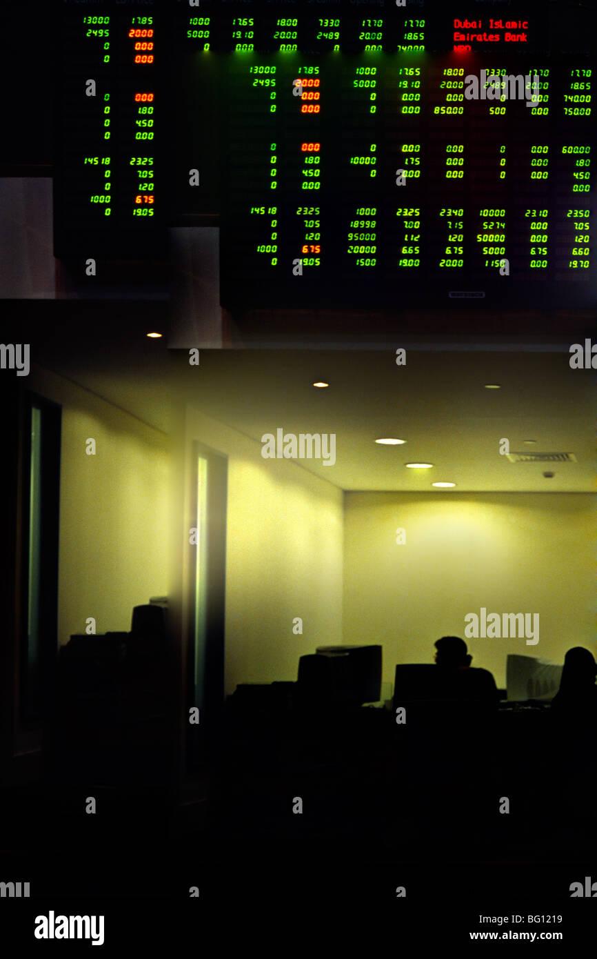 Dubai Stock Exchange Screens Stock Photos & Dubai Stock