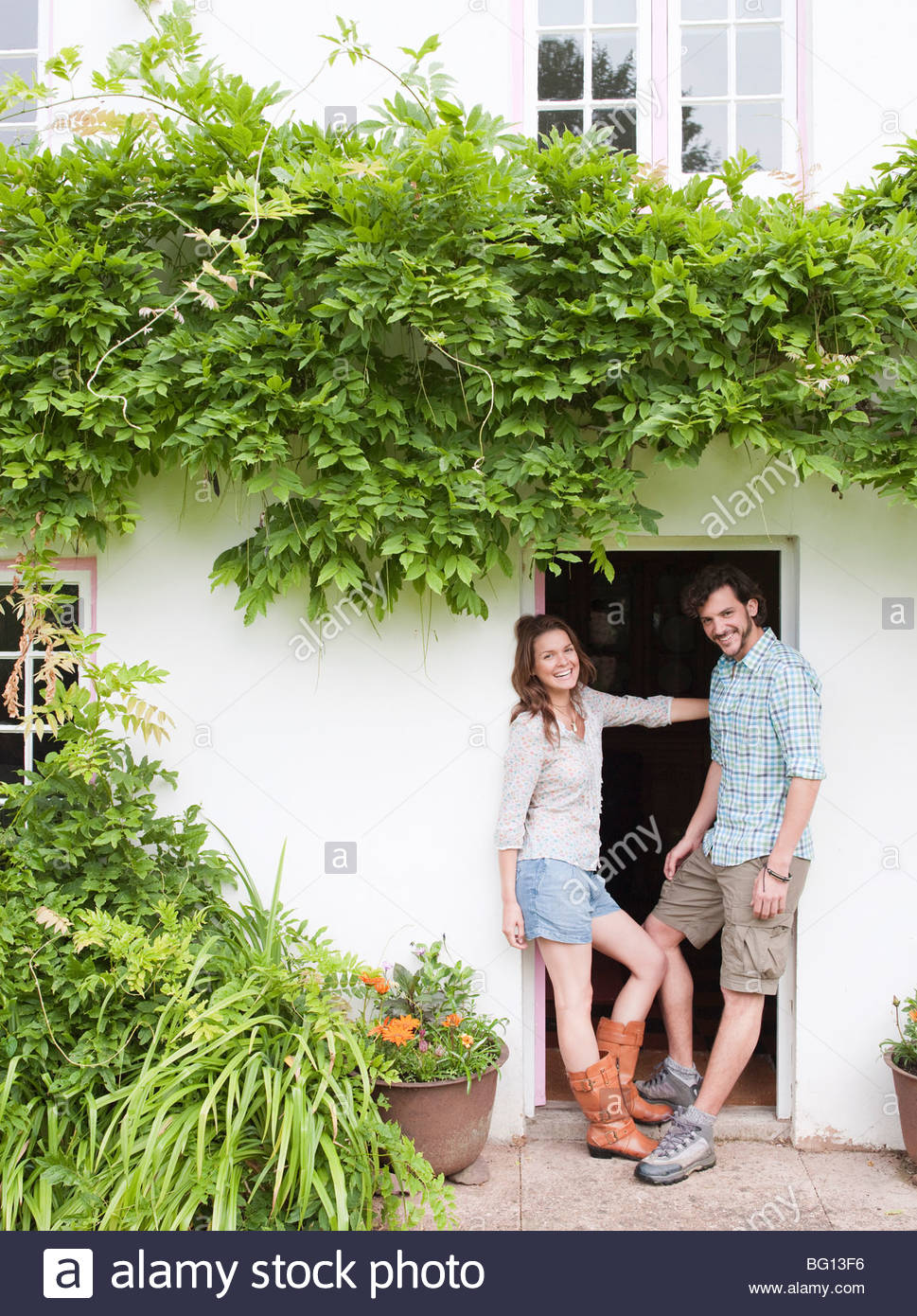 couple by front door of house - Stock Image