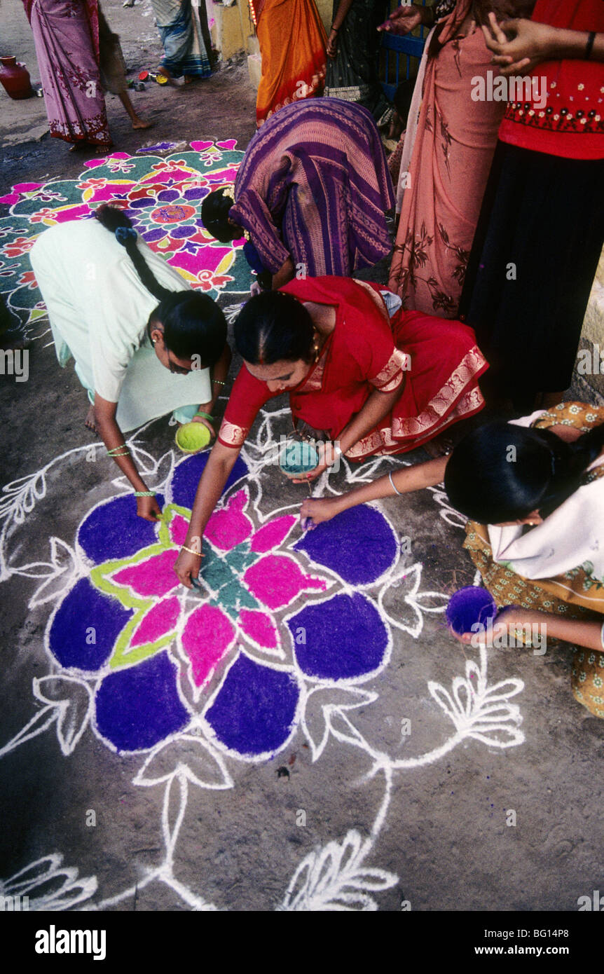 At the Pongol (harvest) festival in Madurai, India every home has a beautiful chalk drawing on the ground outside - Stock Image