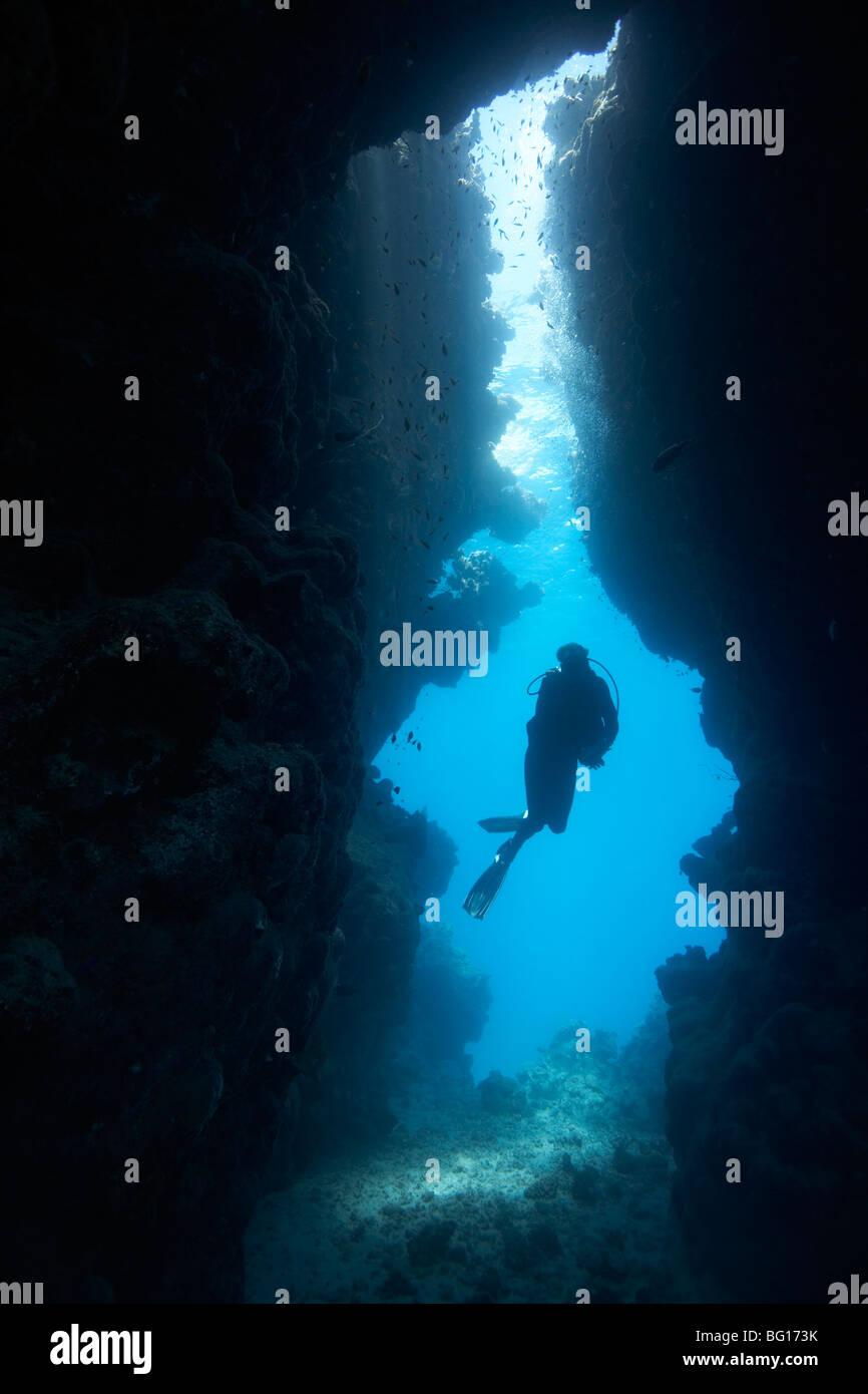 Diver in underwater cave - Stock Image
