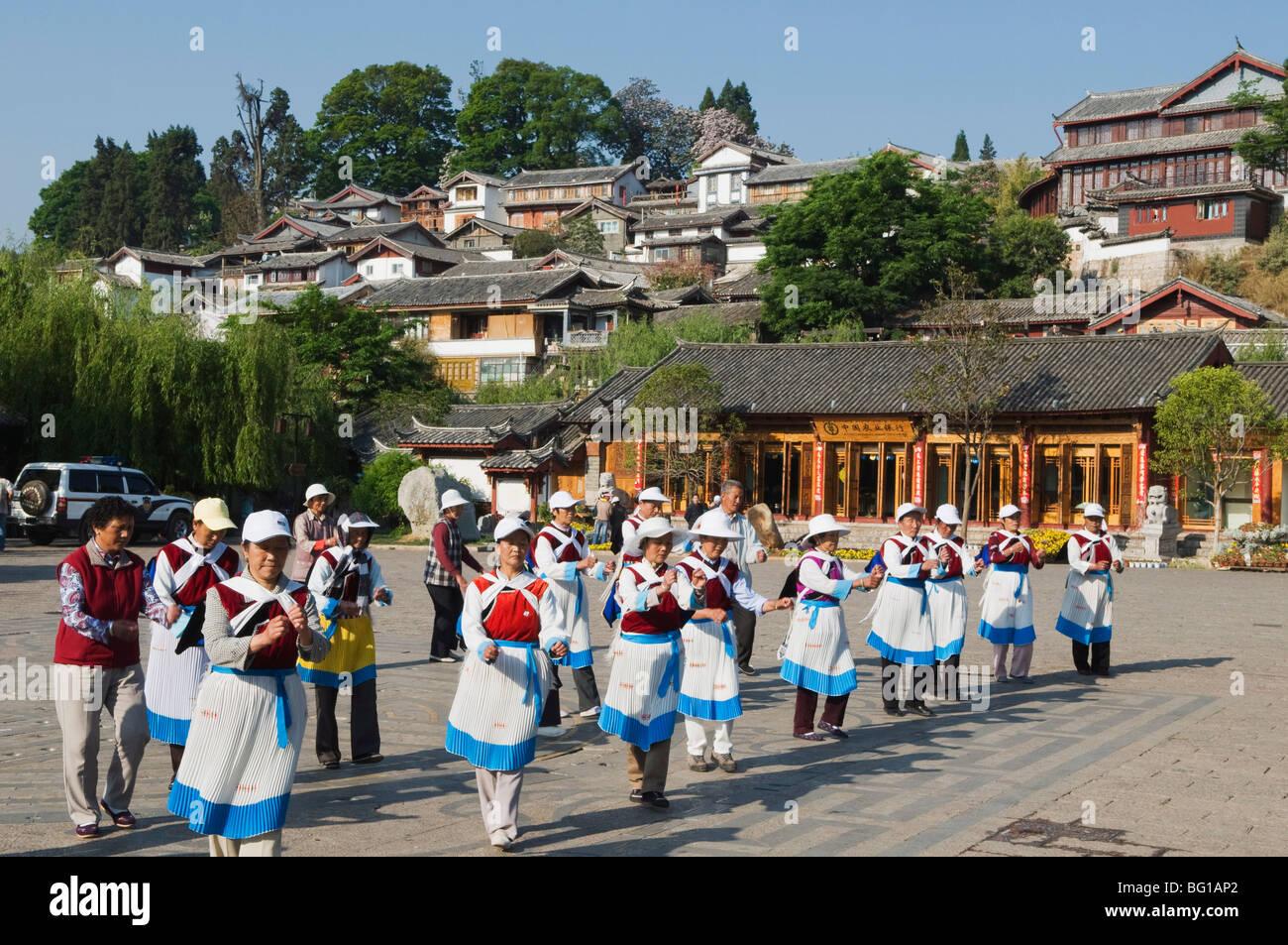Naxi women dancing in Lijiang Old Town, UNESCO World Heritage Site, Yunnan Province, China, Asia - Stock Image