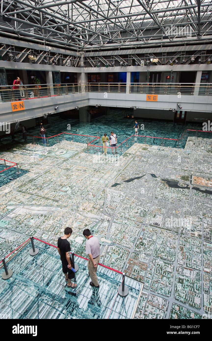 Visitors looking at a scale model of city buildings at the Beijing Planning and Exhibition Hall, Beijing, China, - Stock Image