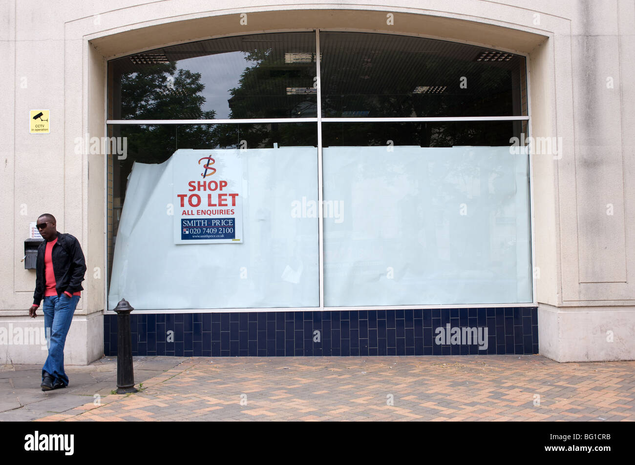 Closed down retail outlet in a shopping centre, Ipswich, Suffolk, UK. - Stock Image