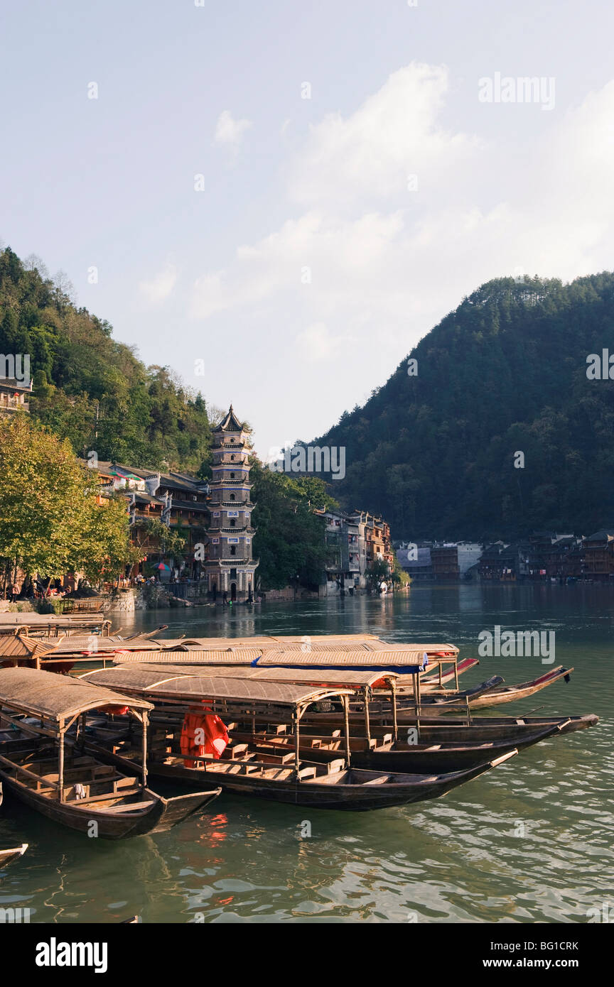 Boats tied up on a river in the old town of Fenghuang, Hunan Province, China, Asia - Stock Image