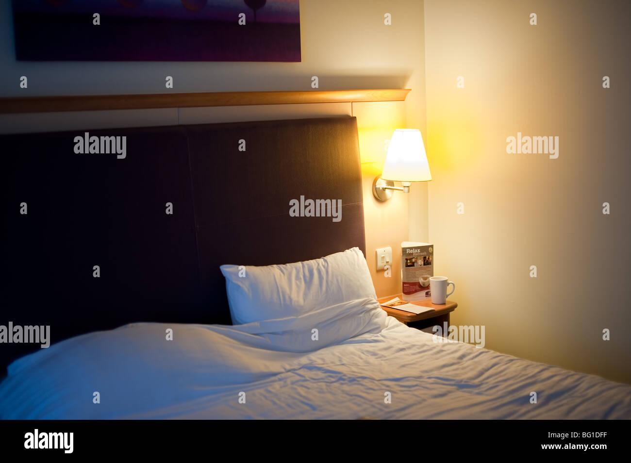 Hotel bedroom - Stock Image