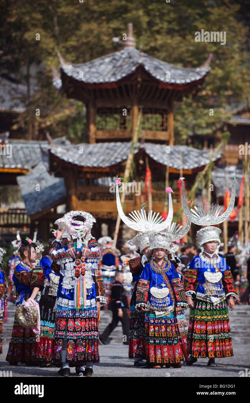 Elaborate costumes worn at a traditional Miao New Year festival in Xijiang, Guizhou Province, China, Asia - Stock Image