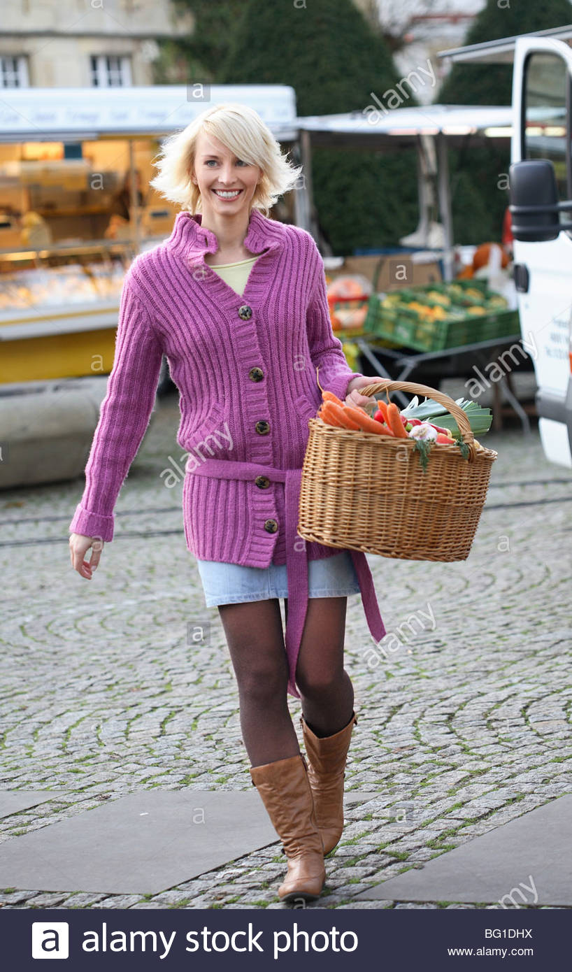blond woman shopping on weekly market - Stock Image