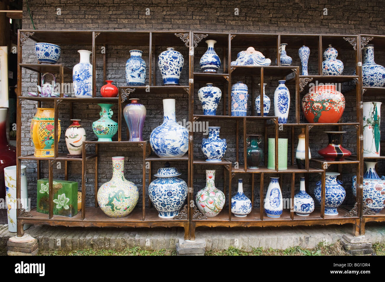 A display of vases at the Qing and Ming Ancient Pottery Factory, Jingdezhen city, Jiangxi Province, China, Asia - Stock Image