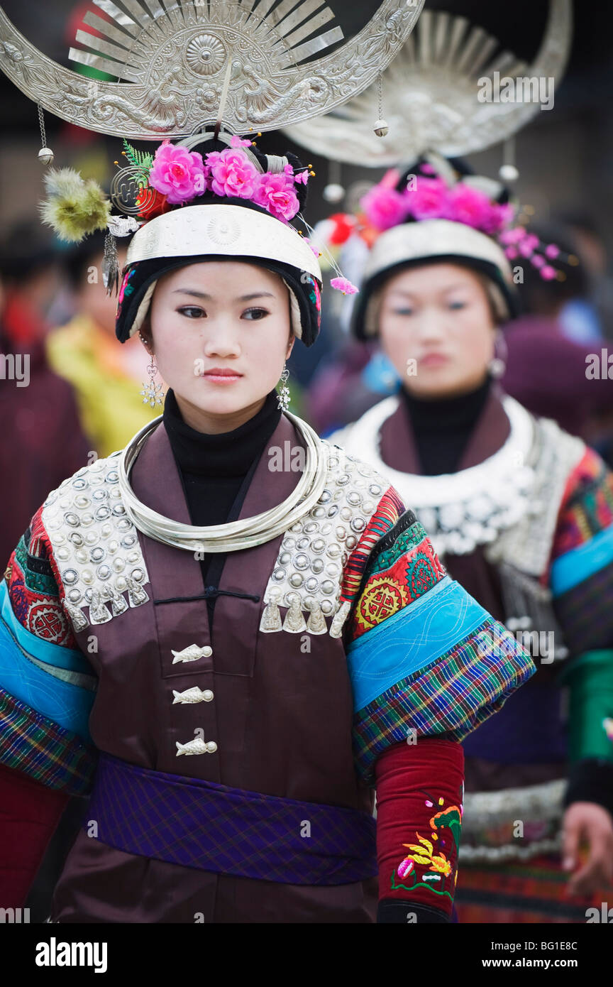Women in ethnic costume at a Lunar New Year festival in the Miao village of Qingman, Guizhou Province, China, Asia Stock Photo
