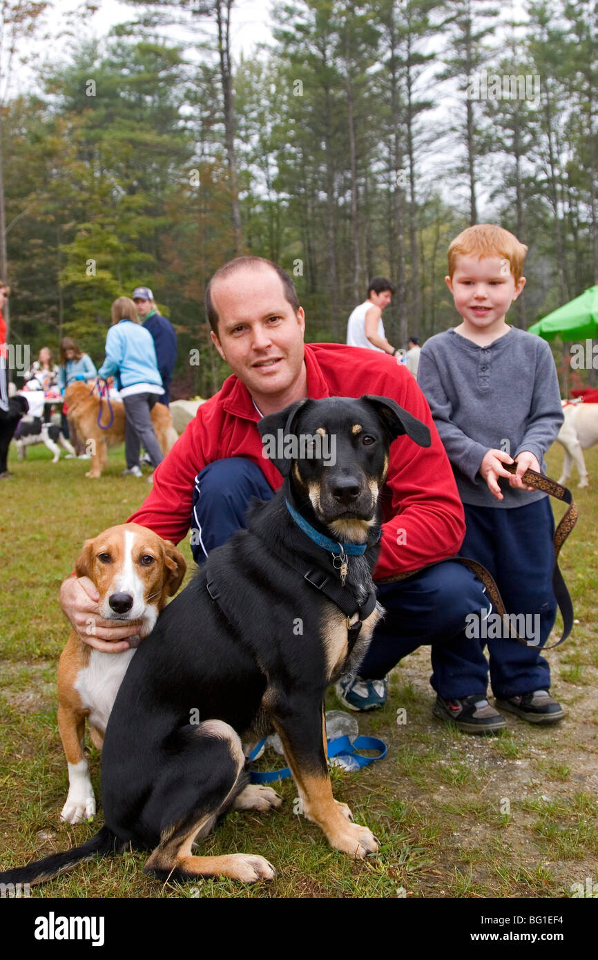 Father and son with two family dogs Stock Photo