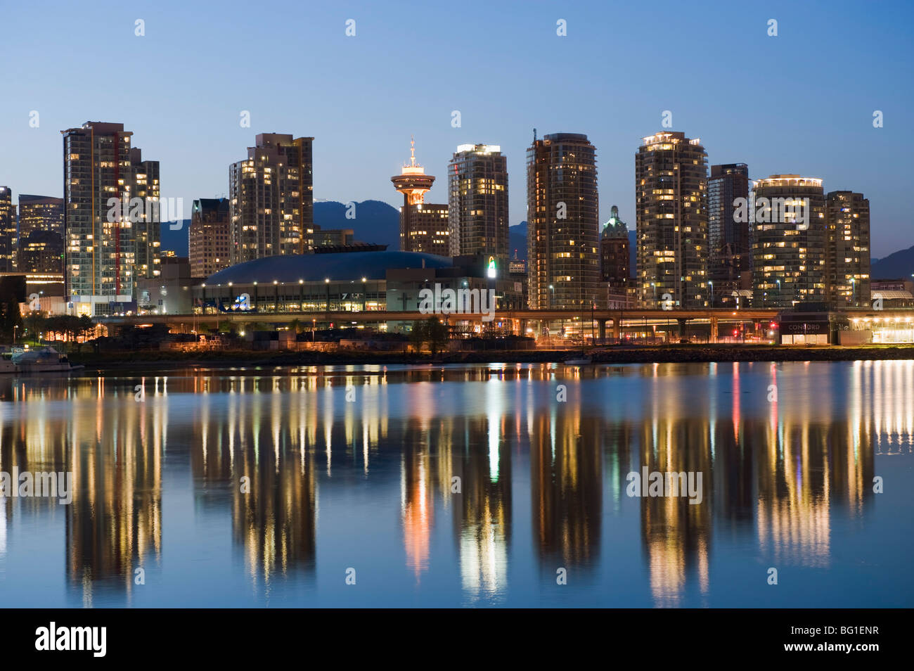 GM Place Stadium and residential city buildings, False Creek, Vancouver, British Columbia, Canada, North America - Stock Image