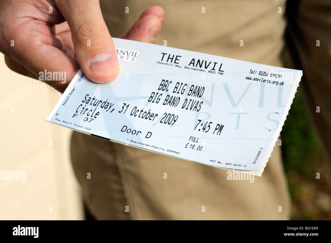 hand holding a theatre admission ticket for entry to BBC BIG Band concert at The Anvil Basingstoke Hampshire England - Stock Image