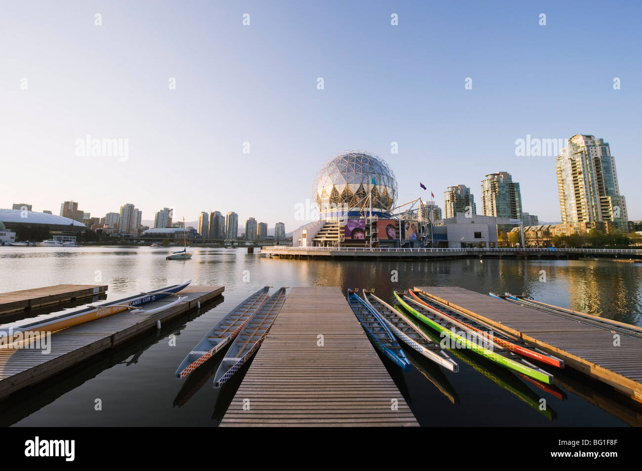 Colourful rowing boats in front of Telus Science World, on False Creek, Vancouver, British Columbia, Canada, North - Stock Image