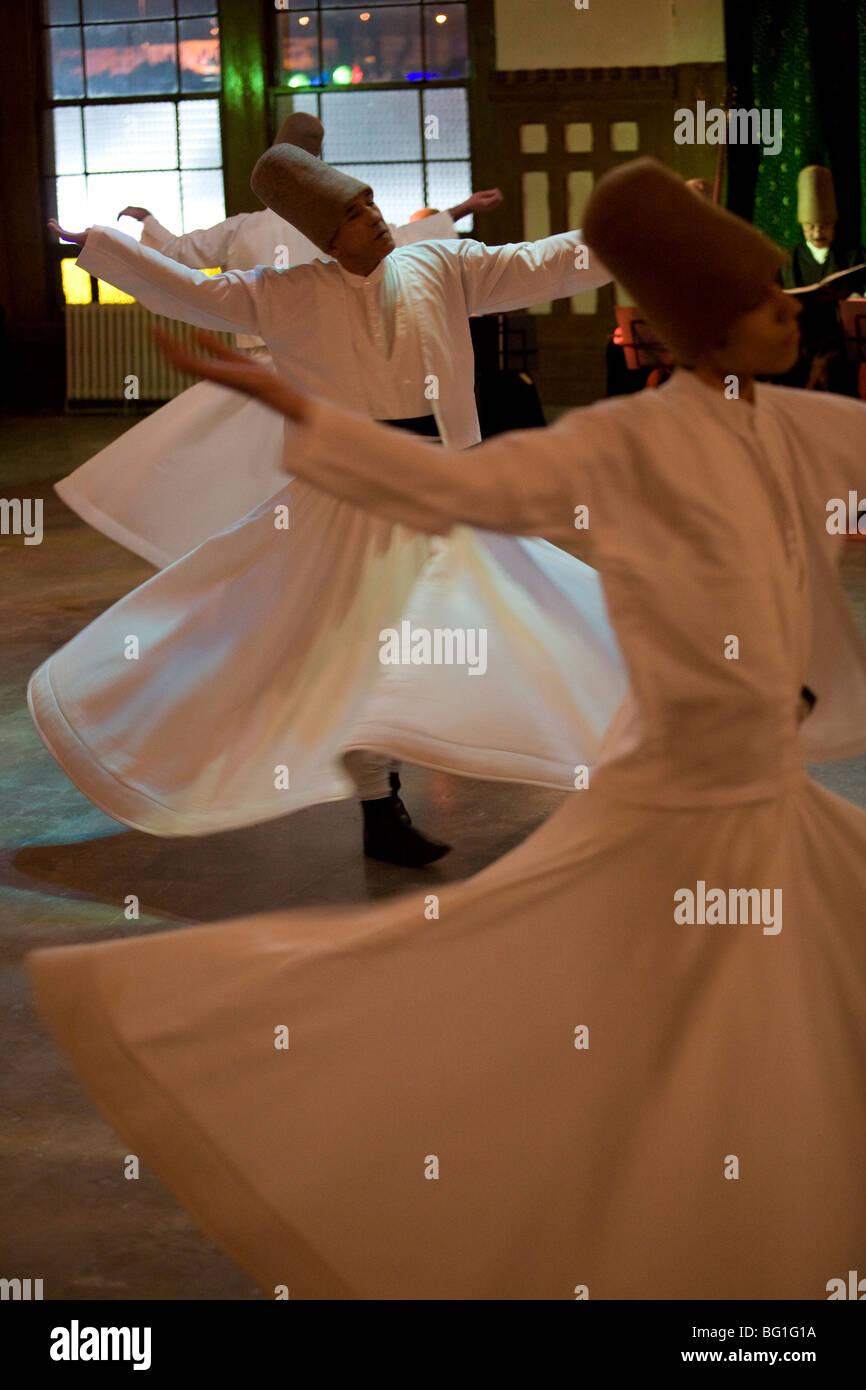 Dervish mystic dance at the Sirkeci station, Istanbul, Turkey, Eurasia - Stock Image