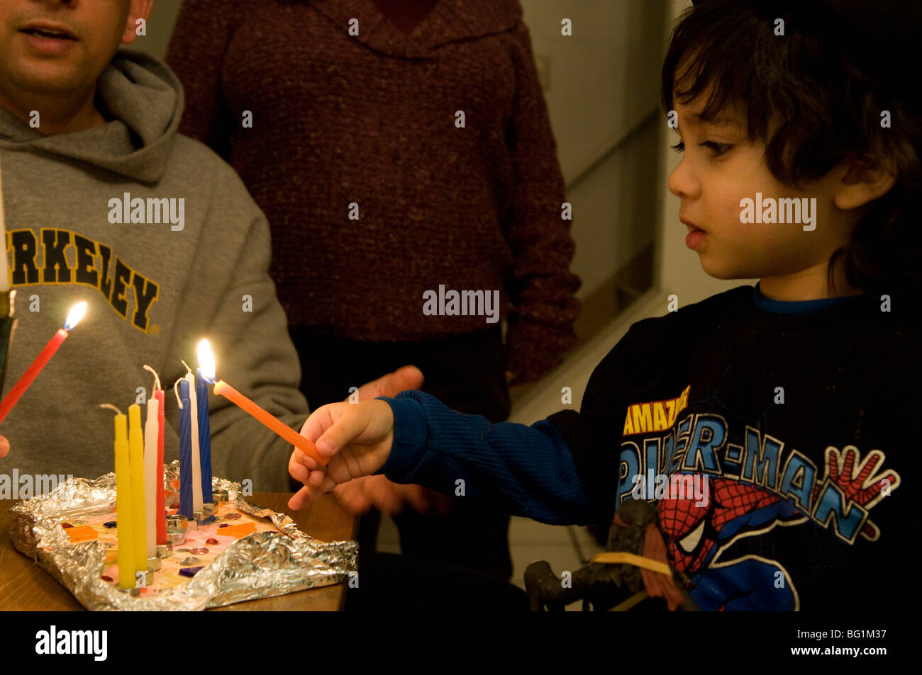 Lighting up the Chanukia during the Jewish festival of Hanukkah. - Stock Image