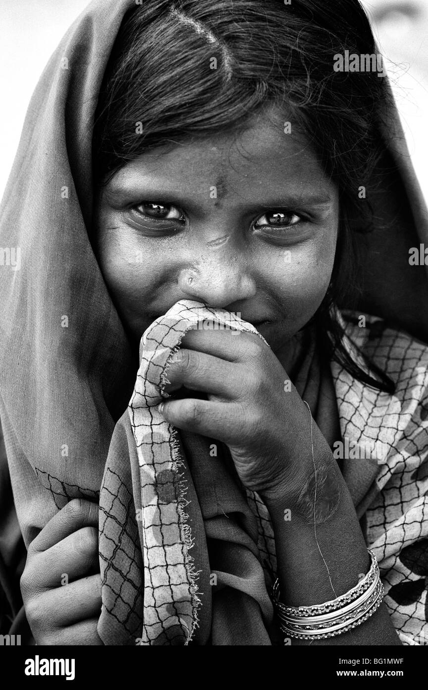 Poor indian street girl portrait black and white stock photo
