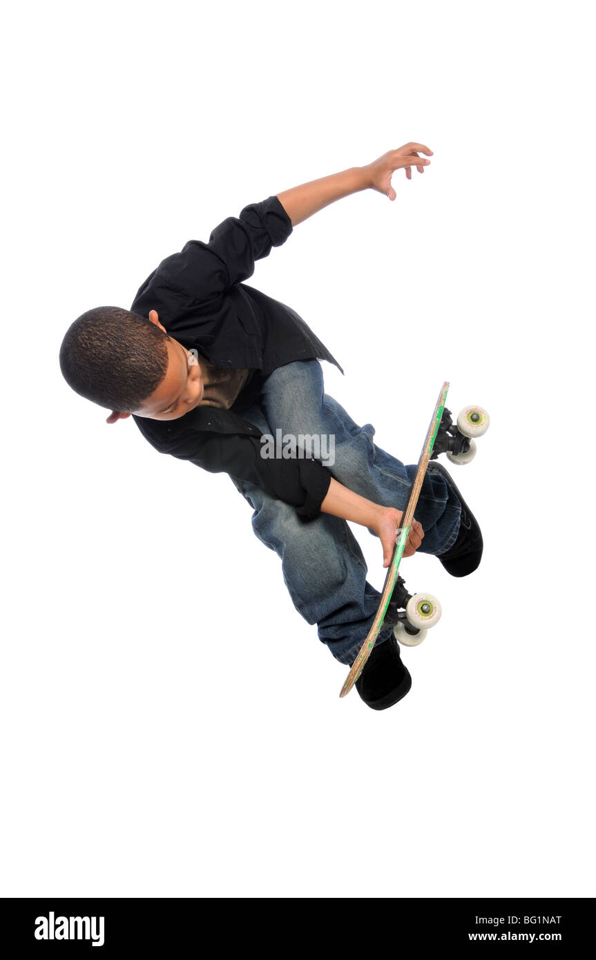 Young skateboarder jumping isolated over white background - Stock Image