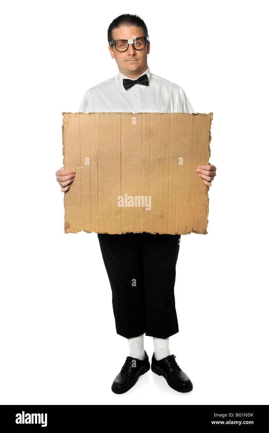 Nerd holding blank cardboard sign isolated over white - Stock Image