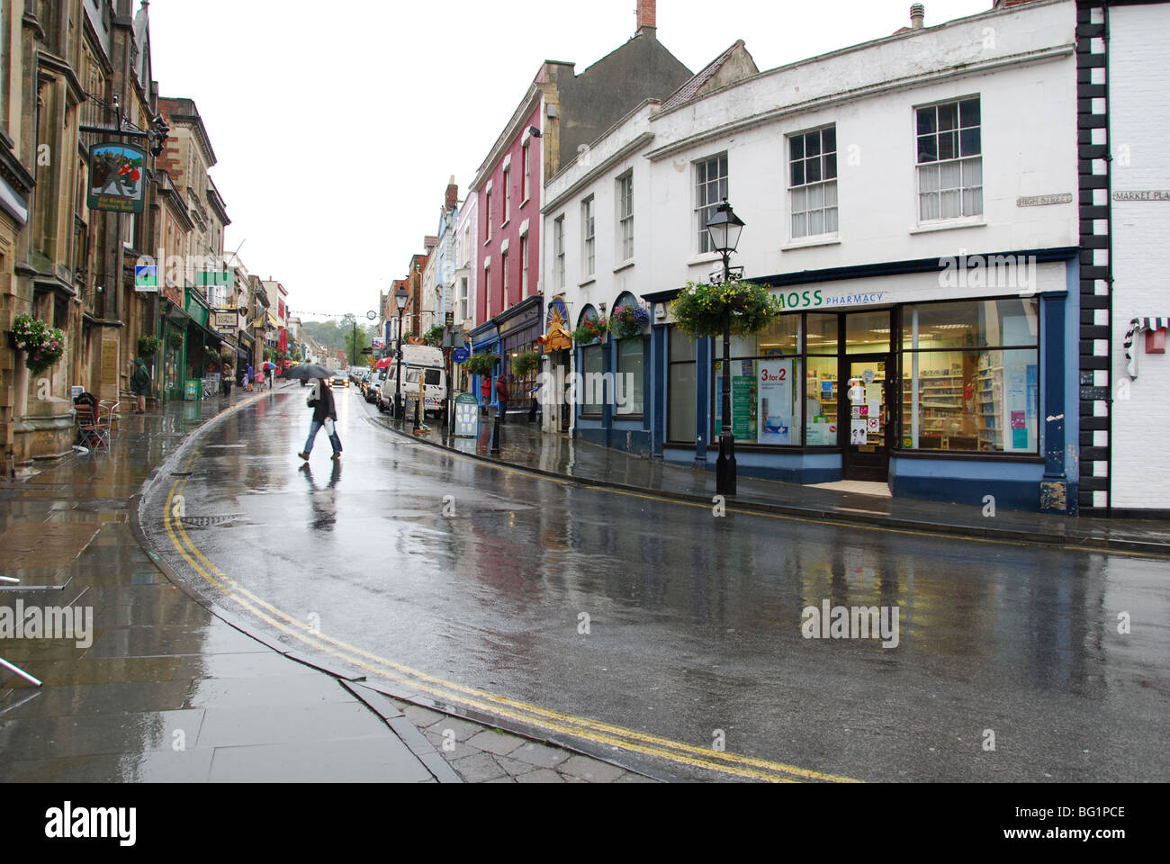 empty Glastonbury High Street in the rain Somerset England - Stock Image