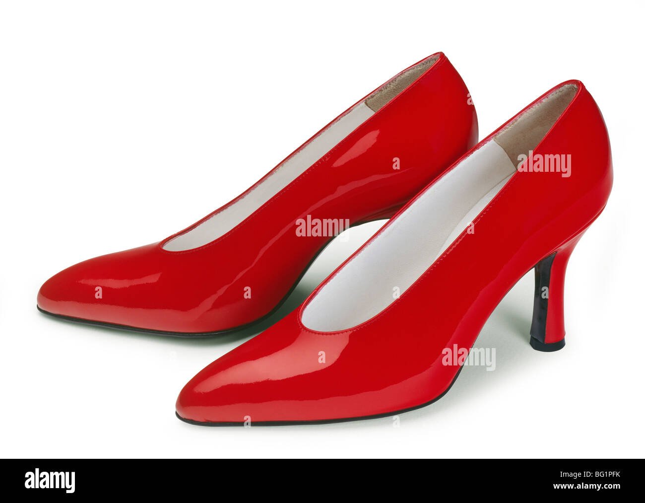 Red high heels isolated on white background. - Stock Image